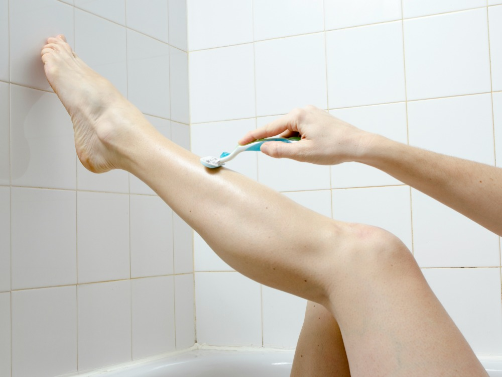 image of shaving legs